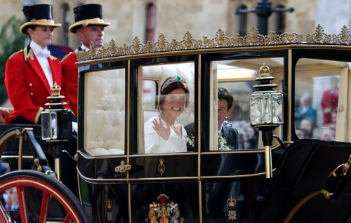 The bride and groom travelled by carriage from the chapel along Windsor High Street and the Long Walk