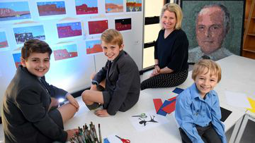 Sydney Grammar Edgecliff Preparatory School students (L-R) Thomas Mansour, 5, Matthew Scolyer, 11, and Savvas Kritharides, 11, pose for a photograph with teacher Janna Tess. (AAP)
